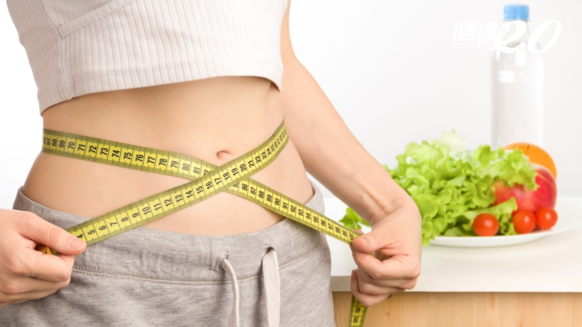 Woman,Measuring,Her,Body.,Diet,And,Healthy,Lifestyle.,Close,Up.
